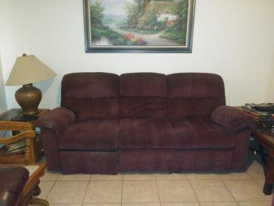 Couch has wear and tear