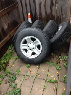 Jeep wrangler JK steel 16 rims with worn tires and perfect spare