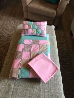 Set of bed cloths for a doll bed or crib size 12/18 or a bit smaller or bigger , pink folded piece is an extra cover for mattress .