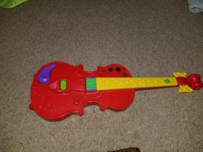 Violin toy plays music