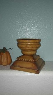 Rustic looking candle holder.