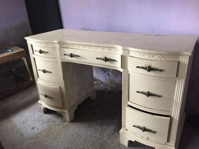 Vintage dresser with sitting chair.