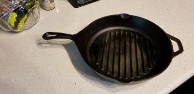 Large griddle cast iron, just oil it up and some pictures seems darker.
