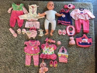 Baby doll with 3 outfit sets