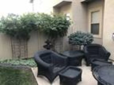 Roommate wanted to share Four BR 2.5 BA Townhouse...