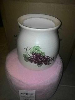 White ceramic pot with leaves and grapes