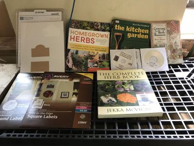 Herb growing books and mini greenhouse/row covers