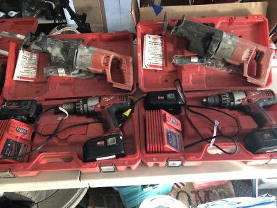 Milwaukee 18 Volt Hammer Drill Kit with 2 Batteries, Charger & Sawzall