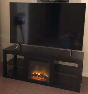 Tv stand w/ built in fireplace heater