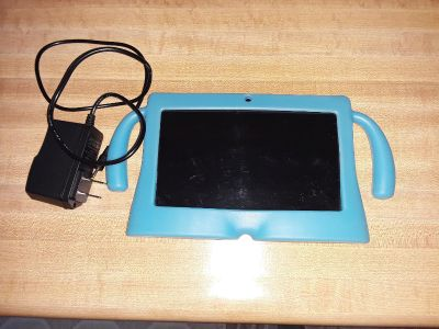 Android Tablet w blue childs case. Comes w charger and instruction manual.Used twice