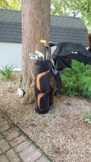 Set of golf clubs and 2 wheel cart