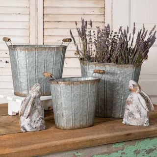 SET OF THREE GALVANIZED METAL TAPERED OVAL PAILS WITH WOOD HANDLES