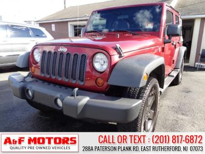 2011 Jeep Wrangler Unlimited Sport (Red)