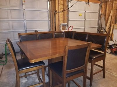 Counter height kitchen table with corner bench & stools