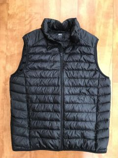 Absolutely beautiful like new men s thin packable down warm vest in size Large
