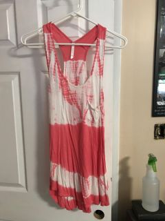 Pink Tye dye tank. Size sm but runs much bigger. Love this top! So pretty with white jeans!