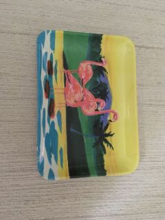Small plastic flamingo tray. About 4 in. X 6 in. Gallatin unless going to H ville. I am selling my Flamingo collection.