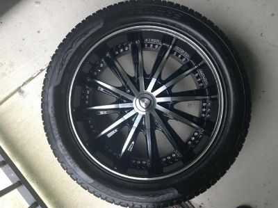 $800, 20 inch black and chrome rims and tires $800