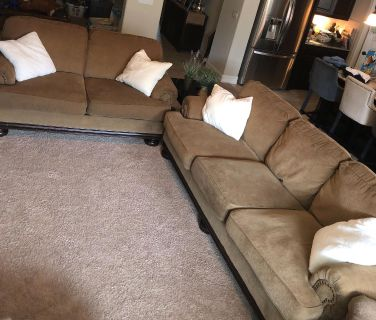 Brown/tan couch and love seat