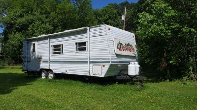 2000 Layton camper. 27' $4000. Sleeps 6. Queen bed, couch & table make beds. Has 1 slide out.