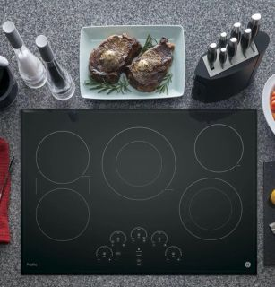 """BRAND NEW!! Still in the Box! GE Profile Series 30"""" Built-In Touch Control Electric Cooktop"""