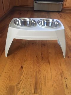 "12"" high double dog stand with 2 stainless steel bowls."