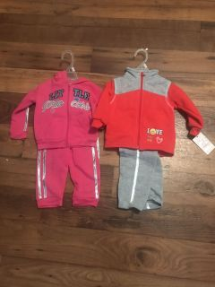 2 sets of Girls 12 month clothing. Brand New With Tags. Asking $10 for both.