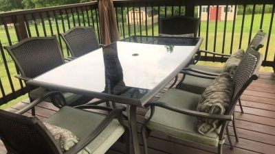 Outdoor dining table, chairs and cushions