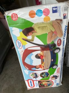 New in box deluxe ride and relax wagon with canopy
