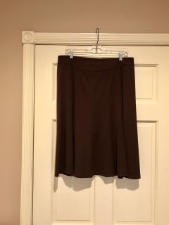 Pretty brown skirt in excellent condition. Rarely worn. 62%, 33% rayon, 5% spandex.