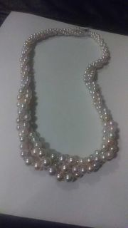 vintage pastel colored pearls. with box not real but nice