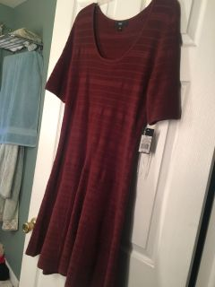 New with tag sweater dress Sz XL. Bought online wasn t color I wanted. This is a burgundy. Flattering fit - I have in black. Not on SALE