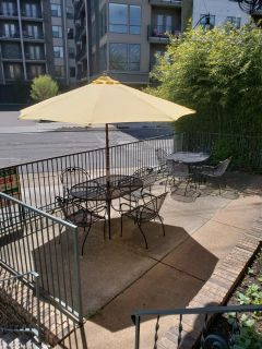 Solid wrought iron table and chairs w/ sun and rain protector