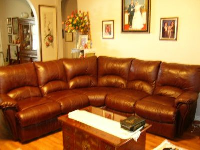 3 Piece leather sectional sofa with recliners