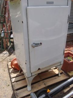 Vintage GE refrigerator.  Does not work.  Perfect for display