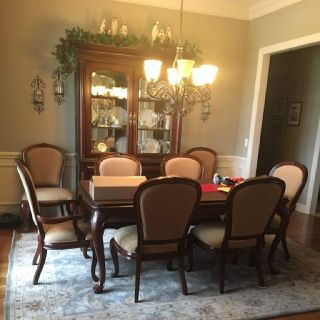 Beautiful Table with 8 Chairs and China with table pads.