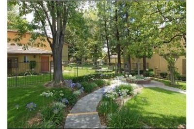 Outstanding Opportunity To Live At The Redlands City Club. Carport parking!