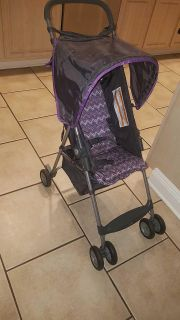 Stroller. Gray and purple. Excellent condition. See more pictures and info! $15