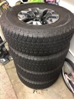brand new Goodyear tires WITH RIMS