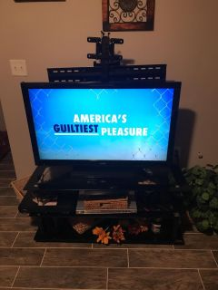 Z line entertainment stand, mounts to tv and swivels