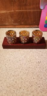 3 votive size candle holders on wood block