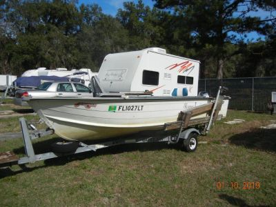14' Starcraft boat, motor and trailer