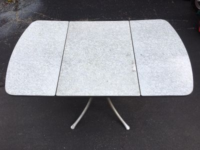 Gray Formica top drop leaf table
