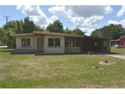 Compact, concrete block 2 bedroom home on a spacious lot in South Lake Wales