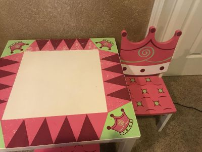 Used Wooden Princess Table with 2 matching chairs . Table has some scratches but very nice solid wood. Could be great to paint.