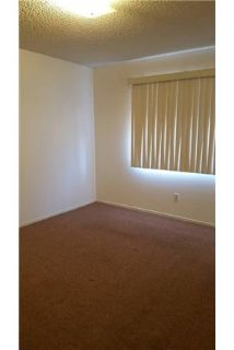 - home 3 bedroom 2 bath with spacious living room, stove.
