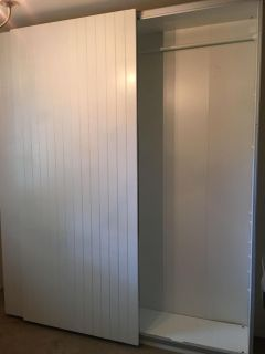 Sliding door wall cabinet( looks like another wall with lots of adjustable storage shelves)