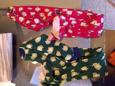 2 pairs size 7 footy pjs.