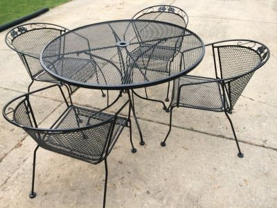 Wrought iron patio set one table four chairs