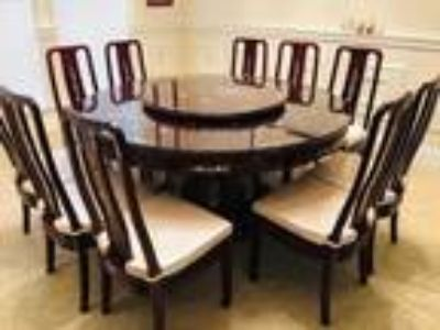 Red Wood Round Dinning Table and Ten Chairs as a Set.